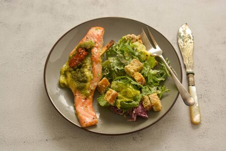 Baked salmon and healthy salad. Top view. Healthy foods.