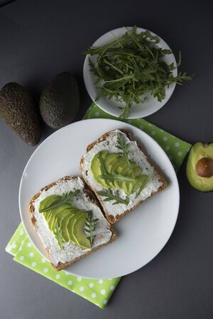 Avocado sandwich toast bread made with fresh sliced avocado, cream cheese. healthy food concept. Food. Breakfast or snack.