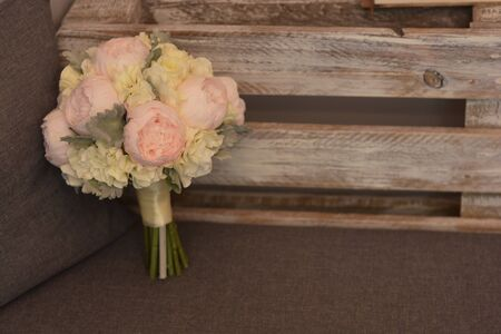 Close-up bouquet of flowers with peonies. Beautiful bridal, wedding flowers arrangement.