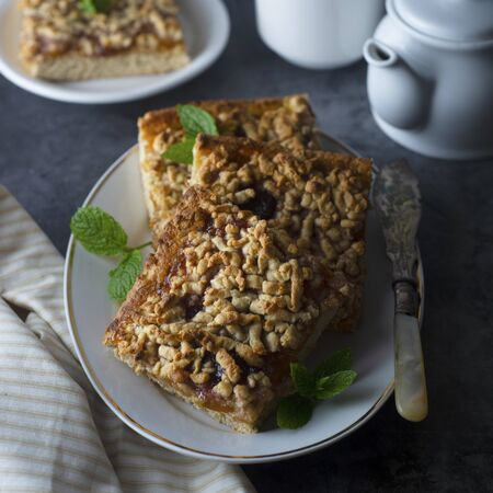 Crumble fruit pie, slice. Homemade cake with fruit jam. Delicious desert or breakfast.
