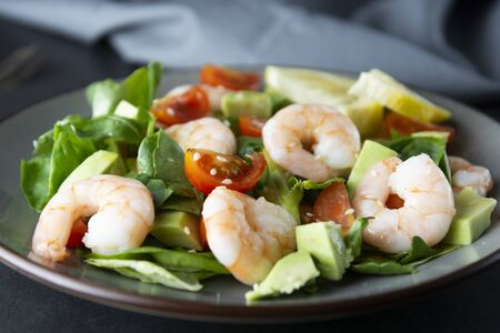 Salad with avocado, shrimps and cherry tomatoes. Healthy fresh salad. 写真素材