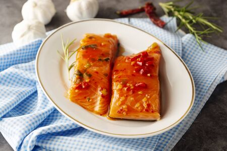 Marinated slices of salmon fillet. Cooking healthy food. Sea foods Фото со стока