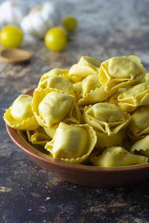 Tortellini pasta, italian traditional pasta with meat or vegetables. Homemade food.