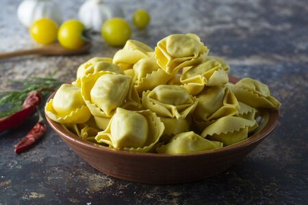Tortellini pasta, italian traditional pasta with meat or vegetables. Homemaker food.
