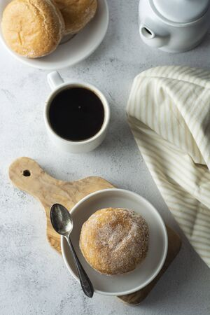 Donuts and coffe cup, breakfast or desert.