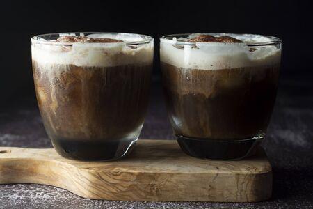Affogato coffee with ice cream on a glass cup. Caffeine drink. Dark background.