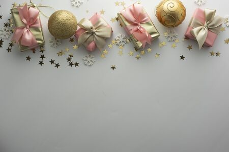 Christmas, baubles golden gift boxes party, birthday background. Celebrate shinny surprise copy space. Creative flat lay.