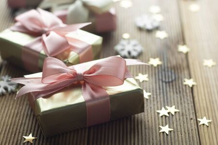 Golden gifts Christmas, party, birthday background. Celebrate shinny surprise boxes copy space wooden background