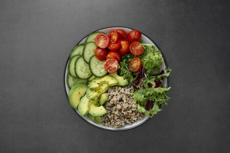Healthy food. budha bowl with quinoa, avocado, cucumber, salad, tomatoe, olive oil Clean eating diet food Reklamní fotografie