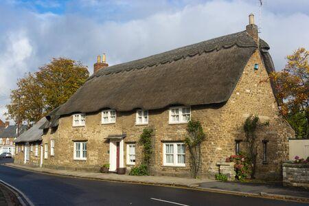 Oakham, United Kingdom. October 19, 2019 - English traditional orange brick wall building.