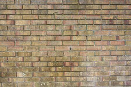 Background of brick wall texture. Old grunge outdoor orange stone texture, english brick wallpaper