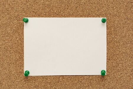 Note paper swith push pins on cork board. Empty paper pages for notes copy space for text.