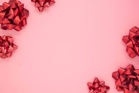 Abstract pink background with red gift ribbon bows. Valentines Day, Love, Birthday Stock Photo