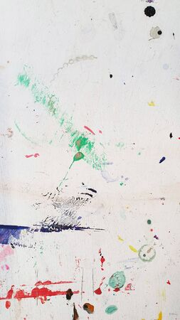 Textured abstract white background or table with paint colorful paint stains and splashe