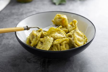 Cooked tortellini on a plate, close up pasta, italian food.