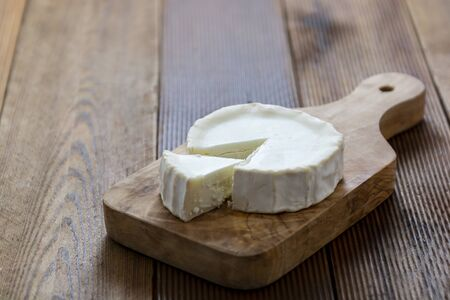Cheeses on wooden background isolated.Dark food photo.