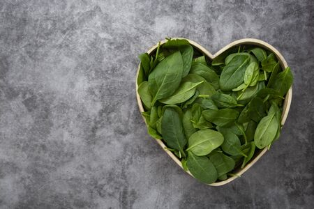 fresh spinach leaves or spinach salad background Stock fotó