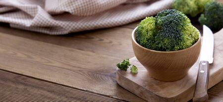 Fresh broccoli on wooden table. Healthy food. Banner.