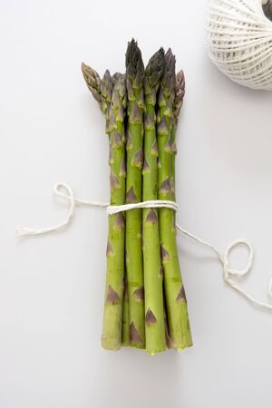 Asparagus heap isolated. Fresh vegetables, top view
