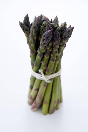 Heap of fresh asparagus isolated. Fresh vegetables.