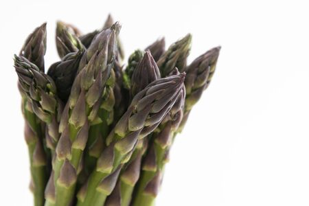 Asparagus heap isolated. Fresh vegetables. Copy space for text.