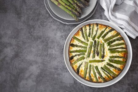 Asparagus tart pastry. Healthy pie filled with fresh asparagus. Vegetarian food.