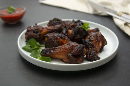 Glazed bbq chicken legs, drumsticks on plate, isolated Stock Photo