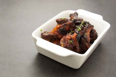 Barbecue chicken legs, drumsticks on plate Stock Photo