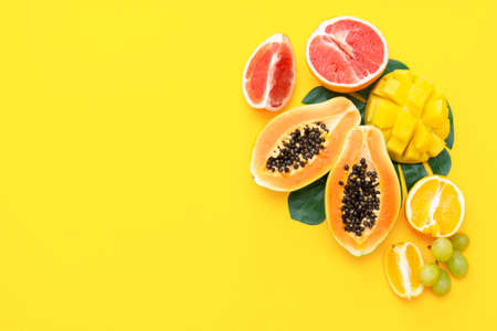 Summer colorful background with fresh various fresh fruits. Copy space. Delicious fruits. Food mockup.