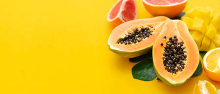 Summer abstract background with mix of various exotic fruits. Yellow fruit banner. Stock Photo
