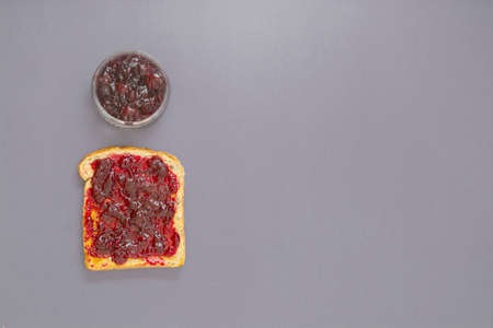 Toasted bread with berry jam, top view with copy space. Traditional breakfast.