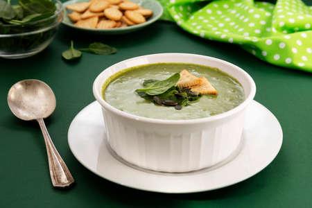 Creamy vegetable soup. Healthy spinach, broccoli vegetarian detox food.
