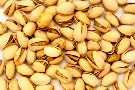 Pistachio nuts background texture, top view, healthy snack. 免版税图像