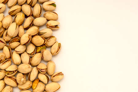 Pistachio nuts, healthy snack on white background. Copy space. 免版税图像