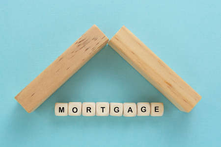 Mortgage word concept blue background