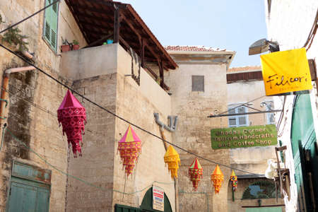 Nazareth, ISRAEL - 10 May 2019: Narrow street with colorful lanterns decorations in old town in Nazareth, Israel.
