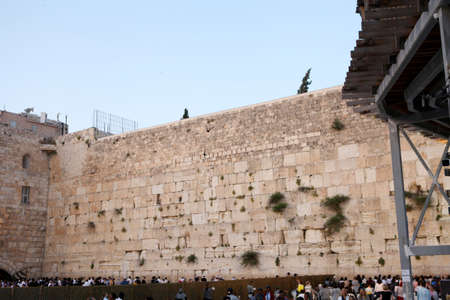 Jerusalem, Israel - 10 May 2019: Western Wall and Worshipers in Jerusalem. The wall is one of the holiest sites in Judaism except for the Temple Mount itself.