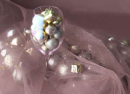 Christmas background with glasses of wine and ornaments over white. vine glass with christmas decorations