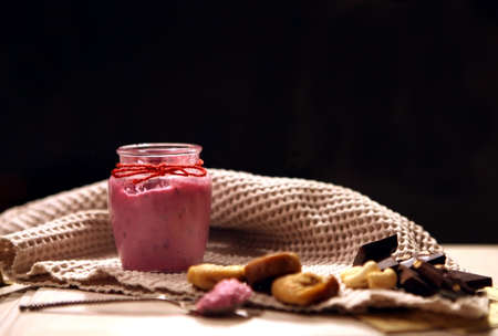 pink creamySmoothie at the bottle. Colorful drink in bottle with fresh vegetables and superfoods on a wooden background. Healthy, clean eating, vegan, vegetarian, detox, dieting breakfast food concept