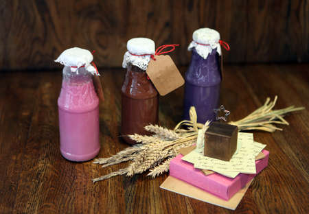 colorful Smoothies at the bottles. Colorful drink in bottle with fresh vegetables and superfoods on a wooden background. Healthy, clean eating, vegan, vegetarian, detox, dieting breakfast food concept 版權商用圖片