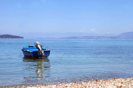 Blue Boat at the sea in summer day time. Sunny weather. travel and vacation concept.  summer sea and blue fishing boat. Stock Photo