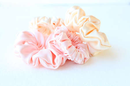 colorful silk Scrunchy isolated on white background. Flat lay Hairdressing tool of Colorful Elastic Hair Band, Bobble Sports Scrunchie Hairband
