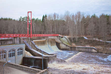 Hydroelectric power station water level at the early winter. Green Energy of moving water. Linnamae hydroelectric power station in Estonia.