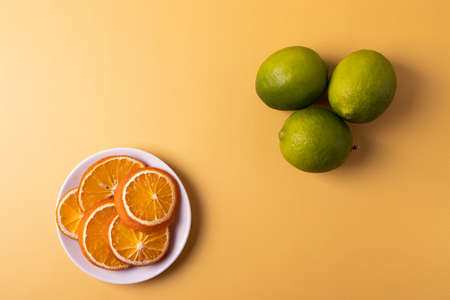 citruses on the yellow. top view