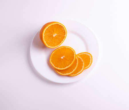 citruses cut in slices on light background