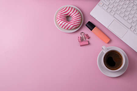 sweet yummy doughnuts and coffee in a ceramic cup