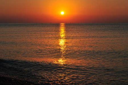 Sunrising at the sea photo