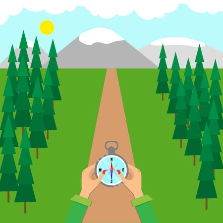 Hands hold a compass on forest road. Terrain orientation concept.
