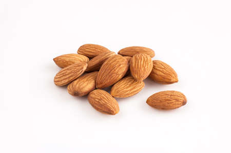Closeup of fresh almonds rendered on white background