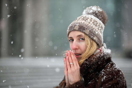 freezing: Young woman freezing in wintertime Stock Photo